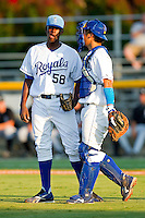 Catcher Jin-Ho Shin #25 of the Burlington Royals talks with his pitcher, Angel Baez #58, during the game against the Bristol White Sox at Burlington Athletic Park on July 9, 2011 in Burlington, North Carolina.  The Royals defeated the White Sox 3-2.   (Brian Westerholt / Four Seam Images)