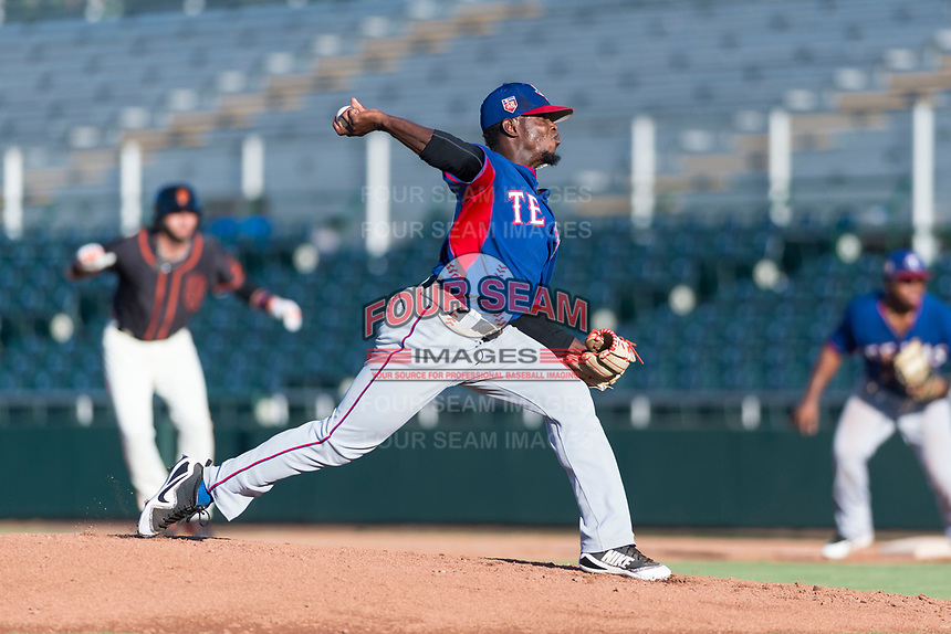 AZL Rangers relief pitcher Ediberto Encarnacion (31) delivers a pitch during an Arizona League game against the AZL Giants Black at Scottsdale Stadium on August 4, 2018 in Scottsdale, Arizona. The AZL Giants Black defeated the AZL Rangers by a score of 3-2 in the first game of a doubleheader. (Zachary Lucy/Four Seam Images)