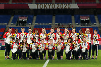 YOKOHAMA, JAPAN - AUGUST 6: Team Canada celebrates their gold medal win and poses with the medals after a game between Canada and Sweden at International Stadium Yokohama on August 6, 2021 in Yokohama, Japan.