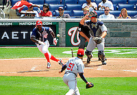 4 July 2009: Washington Nationals' outfielder Nyjer Morgan lays down a bunt against the Atlanta Braves at Nationals Park in Washington, DC. The Nationals rallied with 4 runs in the 8th to defeat the Braves 5-3 and take the second game of the 3-game weekend series. Mandatory Credit: Ed Wolfstein Photo
