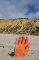 Germany, North Sea Island Sylt, Keitum, sand cliff, rubber glove at beach