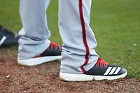 A close-up of the Adidas cleats worn by Jamori Blash (26) prior to the game against the Greensboro Grasshoppers at First National Bank Field on April 6, 2019 in Greensboro, North Carolina. The Suns defeated the Grasshoppers 6-5. (Brian Westerholt/Four Seam Images)