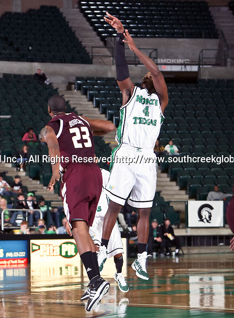 North Texas Mean Green forward George Odufuwa (4) goes up for a jump shot in the game between the Texas State Bobcats and the University of North Texas Mean Green at the North Texas Coliseum,the Super Pit, in Denton, Texas. UNT defeated Texas State 85 to 62