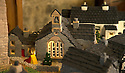 """08/12/16<br /> <br /> All Saints Primary school.<br /> <br /> In this incredibly detailed replica of a small Peak District village, everything is edible, from the baubles on the Christmas trees to the flowers around the houses and what's more the """"village"""" is made from 35 individual rich fruit Christmas cakes which will be eaten on the 25th!<br /> <br /> The amazing model village is made up of 18 shops and houses, which are all realistic reproductions of the actual buildings found in Youlgreave, and is open to the public to view at All Saints' church, the main focal point of the miniature masterpiece.<br /> <br /> Retired florist Lynn Nolan, who decorated all the cakes, came up with the original idea as a way of raising money for the church, which needs a new roof, and the first of the cakes went in the oven back in April.<br /> <br /> MORE...https://fstoppressblog.wordpress.com/the-village-thats-really-a-christmas-cake/<br /> <br /> All Rights Reserved F Stop Press Ltd. (0)1773 550665   www.fstoppress.com"""