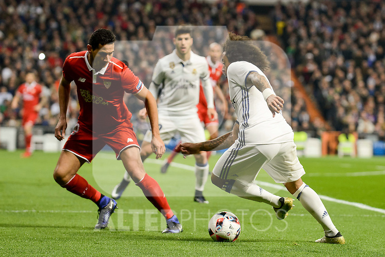 Real Madrid's Marcelo and Sevilla FC's Luciano Vietto during Copa del Rey match between Real Madrid and Sevilla FC at Santiago Bernabeu Stadium in Madrid, Spain. January 04, 2017. (ALTERPHOTOS/BorjaB.Hojas)