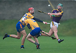 Harry Kehoe of Wexford in action against Peter Duggan and Diarmuid Ryan of Clare during the Jack Lynch Memorial game at Tulla. Photograph by John Kelly.