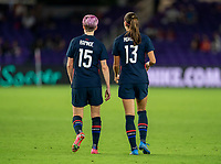ORLANDO, FL - FEBRUARY 24: Megan Rapinoe #15 and Alex Morgan #13 of the USWNT talk during a game between Argentina and USWNT at Exploria Stadium on February 24, 2021 in Orlando, Florida.