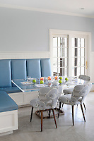 built-in sofa with glass table in kitchen