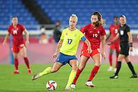 YOKOHAMA, JAPAN - AUGUST 6: Caroline Seger #17 of Sweden passes the ball during a game between Canada and Sweden at International Stadium Yokohama on August 6, 2021 in Yokohama, Japan.