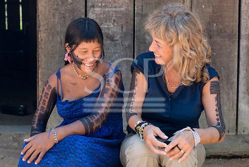 Mato Grosso State, Brazil. Aldeia Metuktire (Kayapo). Sue Cunningham and Bebkwa having a laugh.