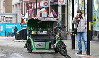 A Rickshaw sits in Oxford Street as Beast from the East weather continues at City of London, London, England on 1 March 2018. Photo by Andy Rowland.