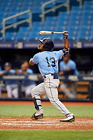Wander Franco (13) follows through on a swing during the Tampa Bay Rays Instructional League Intrasquad World Series game on October 3, 2018 at the Tropicana Field in St. Petersburg, Florida.  (Mike Janes/Four Seam Images)