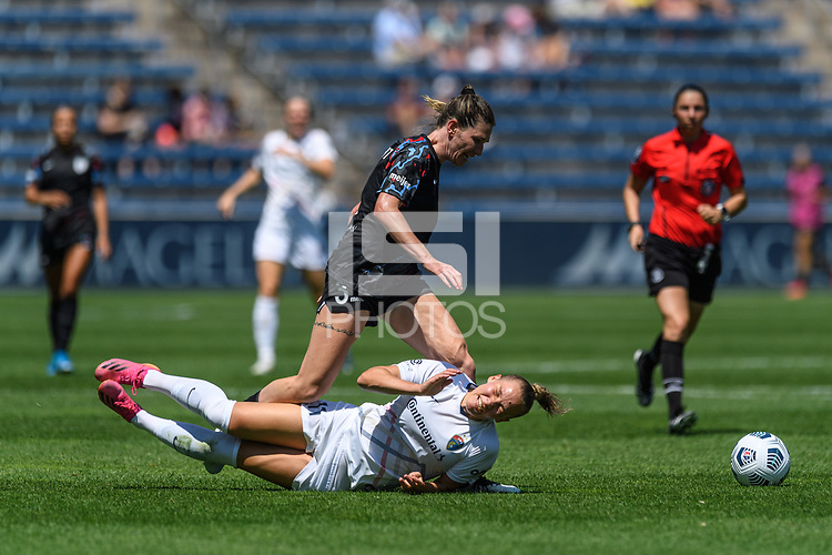 BRIDGEVIEW, IL - JUNE 5: Merritt Mathias #11 of the North Carolina Courage falls after battling for the ball with Arin Wright #3 of the Chicago Red Stars during a game between North Carolina Courage and Chicago Red Stars at SeatGeek Stadium on June 5, 2021 in Bridgeview, Illinois.