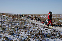 Sunday March 11, 2007   ----    Lance Mackey turns back to see how far behind him Martin Buser is as he nears Unalakleet on Sunday afternoon.