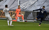KANSAS CITY, KS - OCTOBER 24: #9 Alan Pulido of Sporting Kansas City attempts a shot on goal as #19 Jack Price and #50 William Yarbrough of the Colorado Rapids try to stop him during a game between Colorado Rapids and Sporting Kansas City at Children's Mercy Park on October 24, 2020 in Kansas City, Kansas.