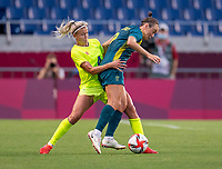 TOKYO, JAPAN - JULY 24: Hanna Glas #4 of Sweden fights for the ball with Caitlin Foord #9 during a game between Australia and Sweden at Saitama Stadium on July 24, 2021 in Tokyo, Japan.