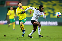 20th February 2021; Carrow Road, Norwich, Norfolk, England, English Football League Championship Football, Norwich versus Rotherham United; Matthew Olosunde of Rotherham United  under pressure from Lukas Rupp of Norwich City