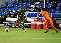 LAKE BUENA VISTA, FL - JULY 18: Sebastián Blanco #10 of the Portland Timbers looks for options as he is pursued by Zarek Valentin #4 of the Houston Dynamo during a game between Houston Dynamo and Portland Timbers at ESPN Wide World of Sports on July 18, 2020 in Lake Buena Vista, Florida.
