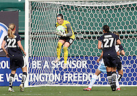 Becky Sauerbrunn #22 and Allie Krieger #27 of Washington Freedom watch Erin McLeod #18 makes a save during a WPS match against Chicago Red Stars at RFK Stadium on June 13 2009, in Washington D.C.
