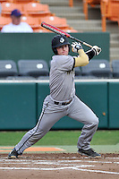 Catcher Carson Waln (4) of the Wofford College Terriers bats in a game against the Clemson University Tigers on Tuesday, March 1, 2016, at Doug Kingsmore Stadium in Clemson, South Carolina. Clemson won, 7-0. (Tom Priddy/Four Seam Images)