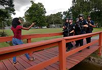 A demonstrator confronts law enforcement officers during a protest against the shooting death of Alton Sterling gather near the headquarters of the police department in Baton Rouge, Louisiana, U.S. July 9, 2016.