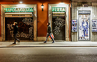 People walk past a closed restaurant in Rome, Italy, March 10, 2020. The Italian government imposed restriction aimed to contain the Covid-19 spread, including cafes, restaurants and other shops forced to close at 6pm and forbidding personal movement.<br /> UPDATE IMAGES PRESS/Riccardo De Luca