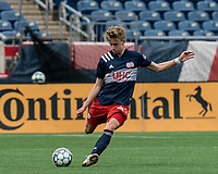 FOXBOROUGH, MA - MAY 12: Joseph Buck #49 of New England Revolution II passes the ball during a game between Union Omaha and New England Revolution II at Gillette Stadium on May 12, 2021 in Foxborough, Massachusetts.