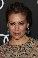 LOS ANGELES, CA - JANUARY 09: Actress Alyssa Milano arrives at the Audi Golden Globe Awards 2014 Cocktail Party held at Cecconi's Restaurant on January 9, 2014 in Los Angeles, California. (Photo by Xavier Collin/Celebrity Monitor)