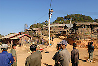 LAO PDR, province Phonsavan, lao german company Sunlabob install local electric grid and small minihydro power station in Hmong village Nam Kha / LAOS Provinz Phonsavan, deutsche laotische Firma Sunlabob installiert kleine Wasserkraftwerke  mit einem lokalen Stromnetz zur autarken Energieversorgung im Hmong Dorf Nam Kha
