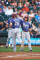 Frisco RoughRiders center fielder Ryan Cordell (20) is greeted at home plate by Isiah Kiner-Falefa (4) after hitting a home run during a game against the Corpus Christi Hooks on April 23, 2016 at Whataburger Field in Corpus Christi, Texas.  Corpus Christi defeated Frisco 3-2.  (Mike Janes/Four Seam Images)