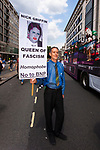 """© Joel Goodman - 07973 332324 . 02/07/2011 . London , UK . PETER TATCHELL with a placard depicting BNP leader Nick Griffin as the """" Queen of Fascism """" . Tens of thousands take part in the annual Pride march in London . Photo credit : Joel Goodman"""