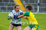 Tomas Lynch Desmonds takes on Owen Fitzgerald during their SFL Div 2 promotion playoff in Fitzgerald Stadium on Sunday