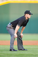 Third base umpire Toby Bashner during the International League game between the Norfolk Tides and the Charlotte Knights at BB&T Ballpark on May 21, 2014 in Charlotte, North Carolina.  The Tides defeated the Knights 10-3.  (Brian Westerholt/Four Seam Images)