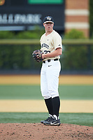 Wake Forest Demon Deacons relief pitcher Chris Farish (32) looks to his catcher for the sign against the Virginia Cavaliers at David F. Couch Ballpark on May 19, 2018 in  Winston-Salem, North Carolina. The Demon Deacons defeated the Cavaliers 18-12. (Brian Westerholt/Four Seam Images)