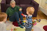 20 month old toddler fraternal twin boys playing with grandmother, child care, she takes care of them twice a week