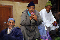 Fez, Morocco - Street Vendors.  The man on the left, Ayachi El-Bachiri, sells rose petals for a living.  The man in the middle, Bachiri Muhammad, sells fava beans.  The man on the right is a friend.