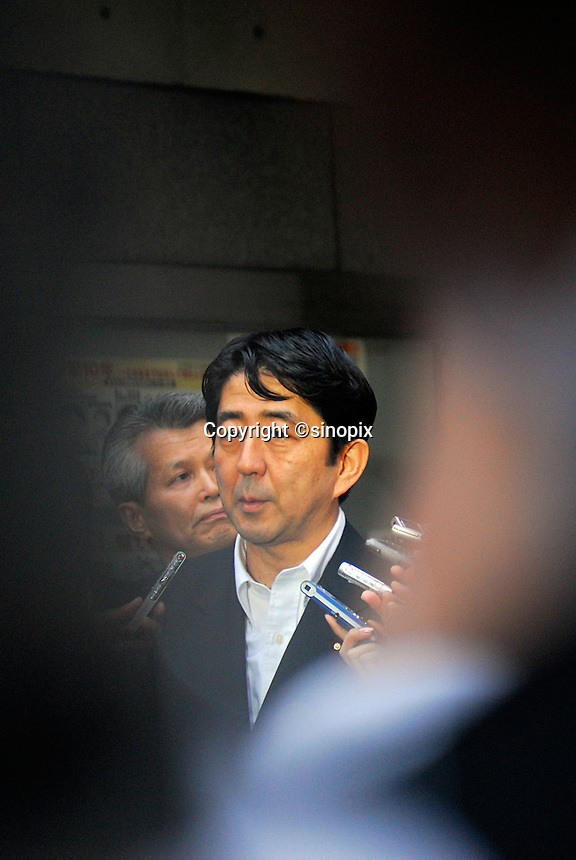 Japan's chief cabinet secretary, Shinzo Abe, 51, considered the most likely sucessor to current Japanese Primi Minister, Junichiro Koizumi when he retires in September, during a walk about in the Shinjuko ward of Tokyo, Japan, <br /> <br /> 08June06