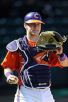 Freshman catcher Chris Okey (25) of the Clemson Tigers prior to the Reedy River Rivalry game against the South Carolina Gamecocks on March 1, 2014, at Fluor Field at the West End in Greenville, South Carolina. South Carolina won, 10-2.  (Tom Priddy/Four Seam Images)