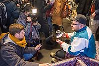 """Adidas-BVG-Turnschuh.<br /> Verkauf des Adidas-BVG-Turnschuh """"Sneaker EQT Support 93"""", im Berliner Turnschuhgeschaeft """"Overkill"""" am Dienstag den 16. Januar 2018.<br /> Der Turnschuh, der auch bis zum 31.12.2018 als BVG-Jahreskarte gueltig ist, wird in einer limitierten Auflage von 500 Stueck verkauft. Jugendlichen und professionelle eBay-Haendler sind bereits seit zwei Tagen Vorort um den Turnschuh fuer 180,- Euro zu kaufen. Die eBay-Haendler wollen den Turnschuh fuer mind. 2.000,-€ verkaufen.<br /> Im Bild: Marc Leuschner, Inhaber der Turnschuhgeschaeft Overkill.<br /> 16.1.2018, Berlin<br /> Copyright: Christian-Ditsch.de<br /> [Inhaltsveraendernde Manipulation des Fotos nur nach ausdruecklicher Genehmigung des Fotografen. Vereinbarungen ueber Abtretung von Persoenlichkeitsrechten/Model Release der abgebildeten Person/Personen liegen nicht vor. NO MODEL RELEASE! Nur fuer Redaktionelle Zwecke. Don't publish without copyright Christian-Ditsch.de, Veroeffentlichung nur mit Fotografennennung, sowie gegen Honorar, MwSt. und Beleg. Konto: I N G - D i B a, IBAN DE58500105175400192269, BIC INGDDEFFXXX, Kontakt: post@christian-ditsch.de<br /> Bei der Bearbeitung der Dateiinformationen darf die Urheberkennzeichnung in den EXIF- und  IPTC-Daten nicht entfernt werden, diese sind in digitalen Medien nach §95c UrhG rechtlich geschuetzt. Der Urhebervermerk wird gemaess §13 UrhG verlangt.]"""