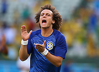 David Luiz of Brazil shouts as he applauds the fans before kick off