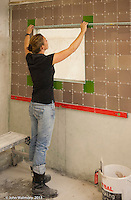 Female trainee tiler,  Able Skills training centre, Dartford, Kent.