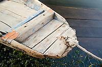 """Close-up view of bow of traditional """"shikara"""" row boat on the shore of Dal Lake, Srinagar, Kashmir, India."""