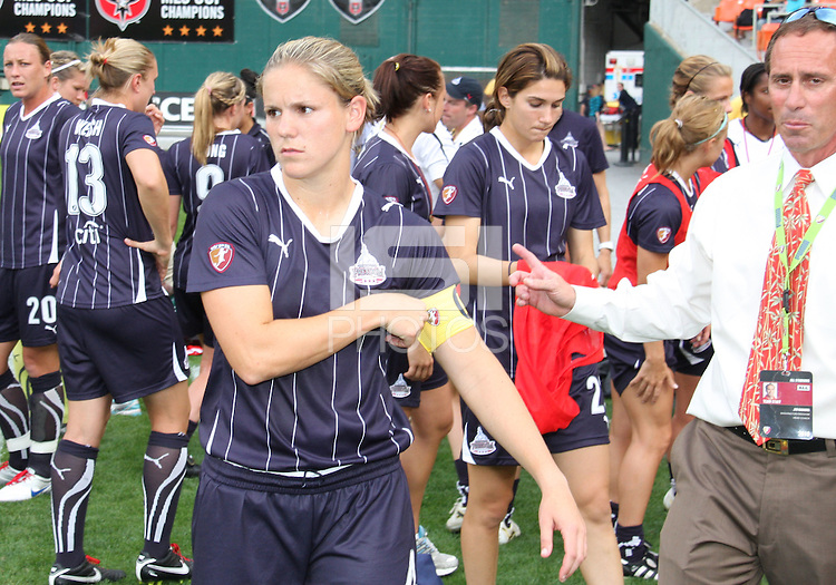 Cat Whitehill #4 of the Washington Freedom with coach Jim Gabarra during a WPS match against ST. Louis Athletica on May 1 2010, at RFK Stadium, in Washington D.C. Freedom won 3-1.
