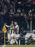 Goal Gonzalo Higuain Calcio, Serie A: Juventus vs Roma. Torino, Juventus Stadium,17 dicembre 2016. <br /> Juventus' Gonzalo Higuain, left, celebrates with teammate Stefano Sturaro after scoring the winning goal during the Italian Serie A football match between Juventus and Roma at Turin's Juventus Stadium, 17 December 2016.<br /> UPDATE IMAGES PRESS/Isabella Bonotto