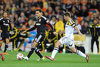 Washington D.C. - March 8, 2014: Fabian Espindola (9) of D.C. United goes against Wil Trapp (20) of the Columbus Crew. The Columbus Crew defeated D.C. United 3-0 during the opening game of the 2014 season at RFK Stadium.