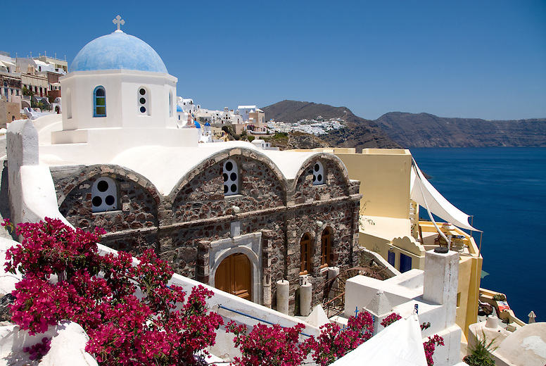 There is a saying that there are more churches in Santorini than the days of a year. Whitewashed with blue domes, Santorini's churches represent Byzantine, Greek Orthodox and Catholic religions among others. Many of the churchs are privately owned by large local families and operate once a year on the owner's name day.   This religious festival includes a traditional meal, singing and folk dancing.