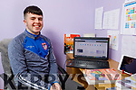 Cian Lenihan studying on line with the help of his school Killorglin Community College at home in Boolteens on Friday.