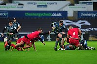 Scott Otten of Ospreys evades the tackle of Richard Barrington of Saracens during the Heineken Champions Cup Round 5 match between the Ospreys and Saracens at the Liberty Stadium in Swansea, Wales, UK. Saturday January 11 2020.