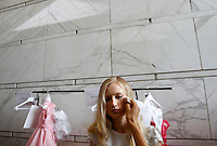 Una modella si prepara per la presentazione della collezione Autunno Inverno 2014-2015 di Sarli Couture durante la rassegna Altaroma, a Roma, 12 luglio 2014.<br /> A model prepares to attend the presentation of Sarli Couture's Autumn Winter 2014-2015 collection at the Altaroma fashion week in Rome, 12 July 2014.<br /> UPDATE IMAGES PRESS/Riccardo De Luca