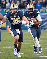 Pitt fullback George Aston (35) blocks for running back Qadree Ollison. The Pitt Panthers football team defeated the Louisville Cardinals 45-34 on Saturday, November 21, 2015 at Heinz Field, Pittsburgh, Pennsylvania.